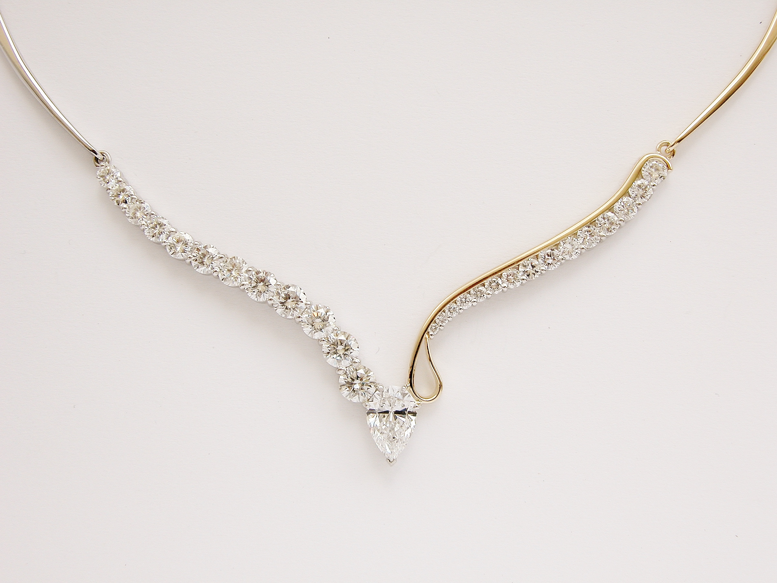 Bespoke Single Pear shaped diamond & 27 stone roundbrilliant cut diamond necklace mounted in platinum &18ct.yellow gold with individually hand crafted links.
