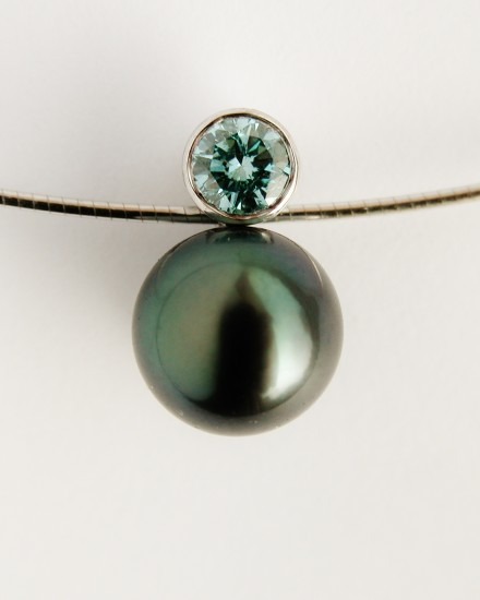 Black Tahitian pearl & ocean blue diamond pendant mounted in 18ct. white gold.