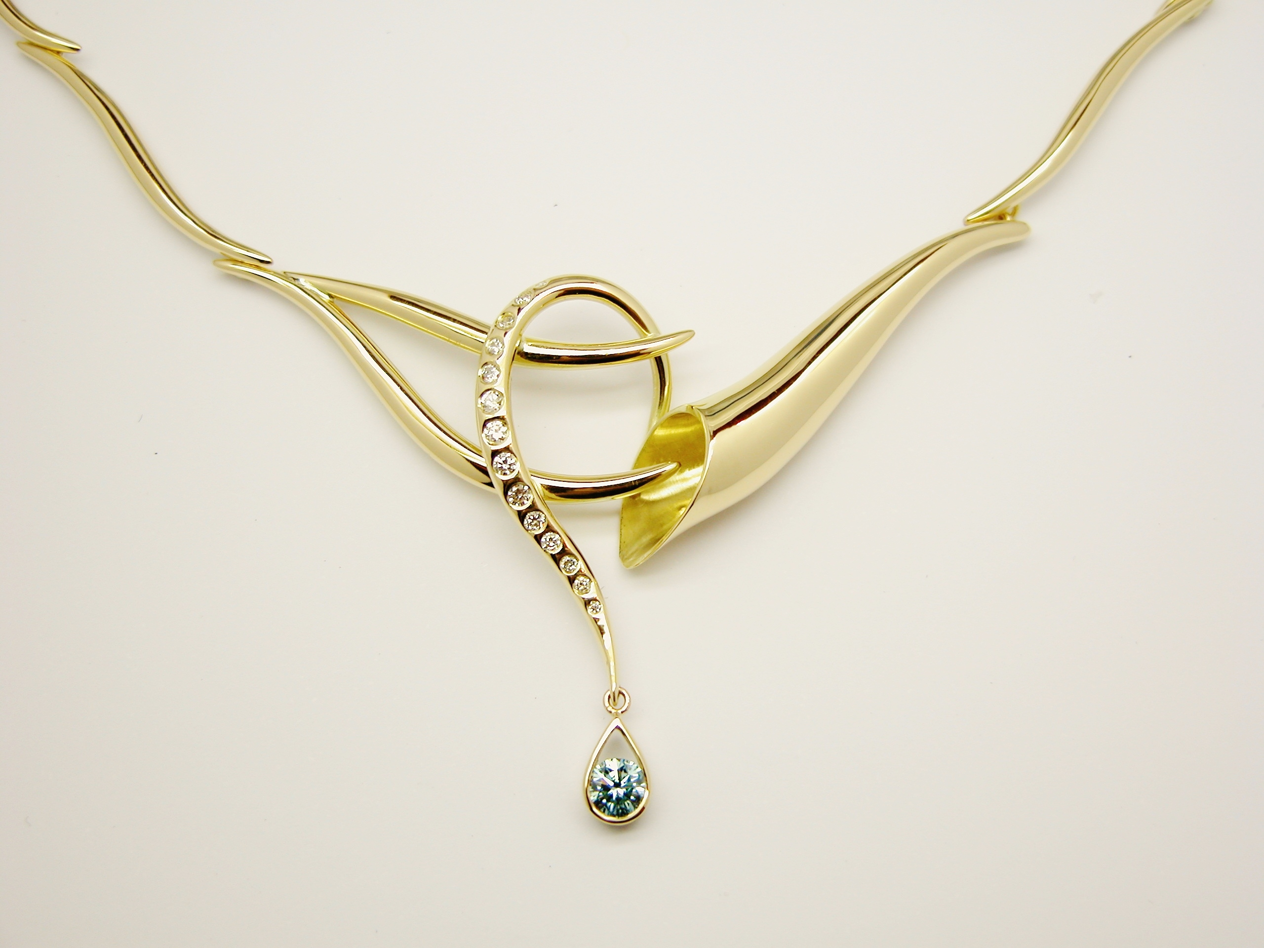 Hand crafted 18ct. yellow gold horn & loop shaped centre panel necklace flush set with round white diamonds and 1sky blue round diamond.