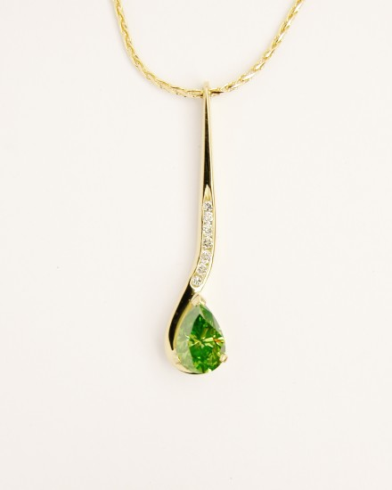 Olive coloured Pear shaped diamond and round brilliant cut white diamond hook shaped pendulum style pendant mounted in 18ct. yellow gold.