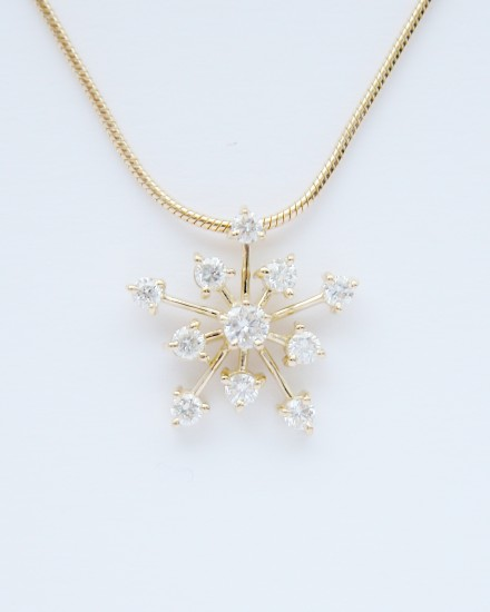11 stone round brilliant cut diamond Snowflake style pendant mounted in 18ct. yellow gold.