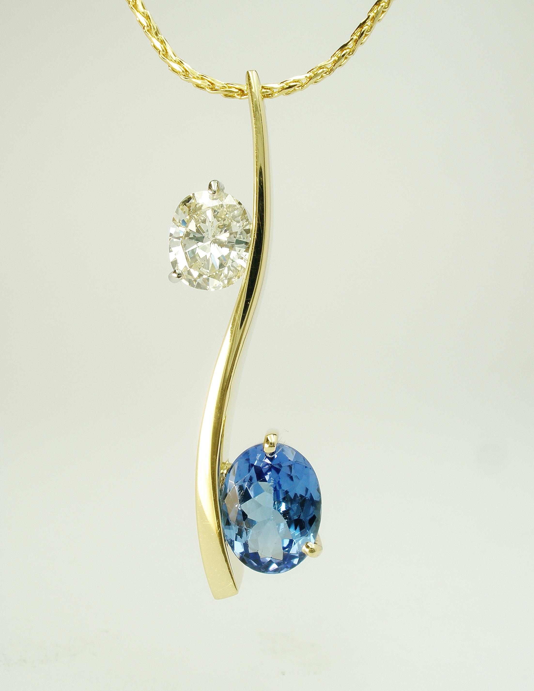 Oval sapphire & oval diamond 2 stone 'S' shaped 18ct. yellow gold pendulum style pendant.