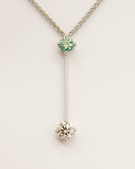 Ocean Blue diamond & white diamond 18ct.white gold'pendulum' style pendant_