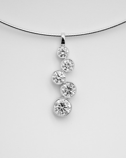 5 stone rub-over set round brilliant cut diamond 'tumble' pendant.