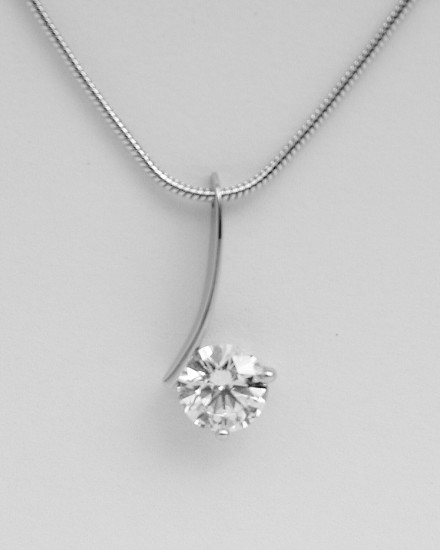 Single round brilliant cut, fine arc wire 'floating' diamond pendant.