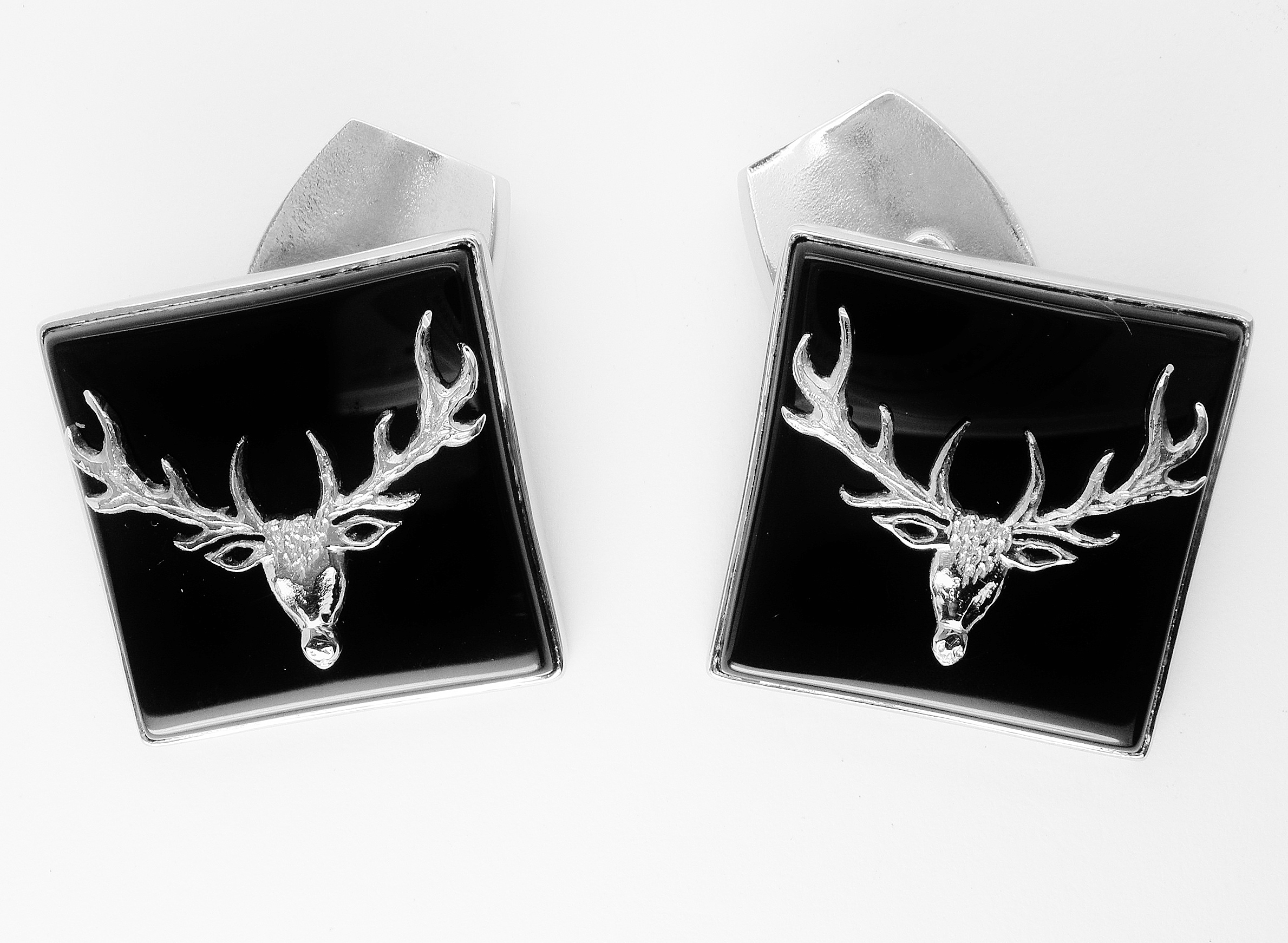 Palladim and onyx set carved stags head overlay cufflinks.