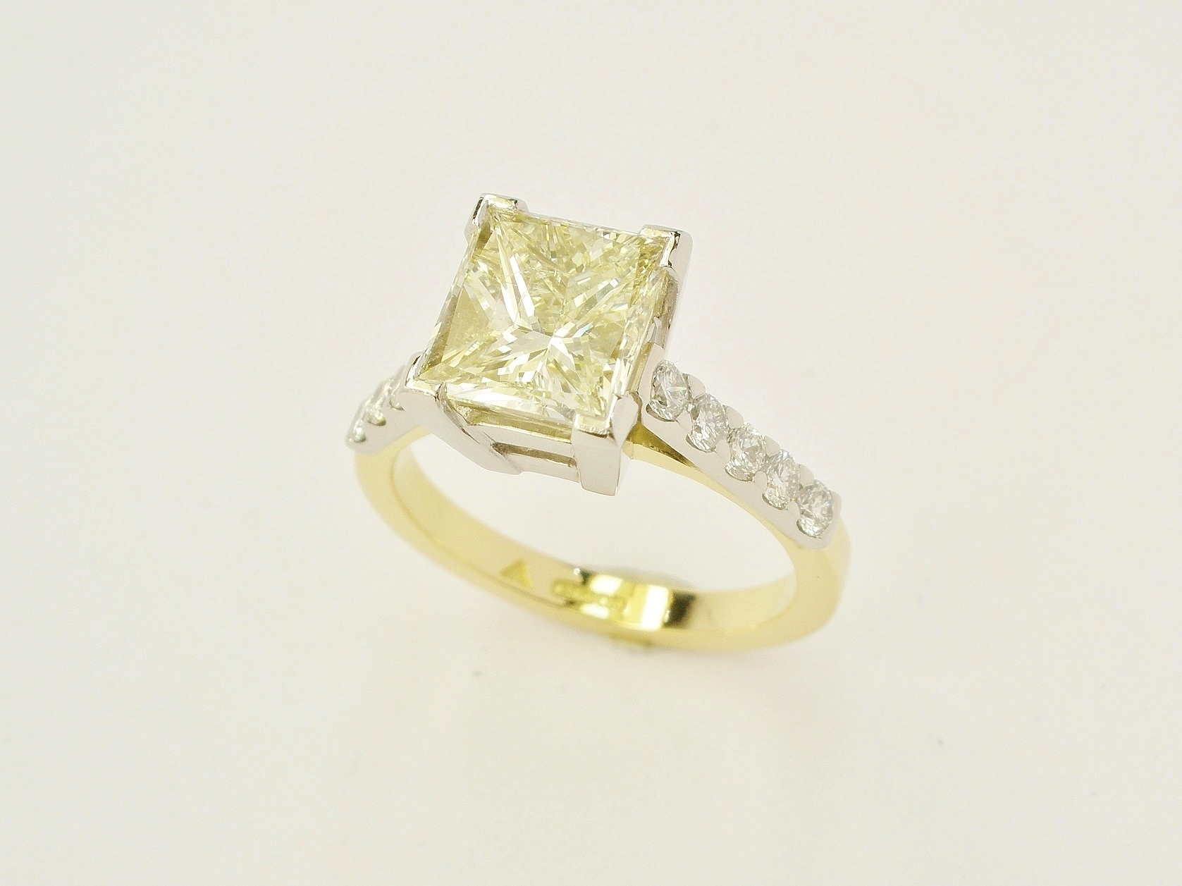 2.01ct. champagne colour princess cut diamond 18ct. yellow gold & platinum ring with 'D' colour round brilliant cut diamonds cut-down set in.