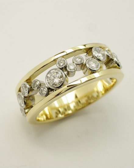 Round brilliant cut diamond 'Bubbles' Ring mounted in 18ct yellow gold and platinum.