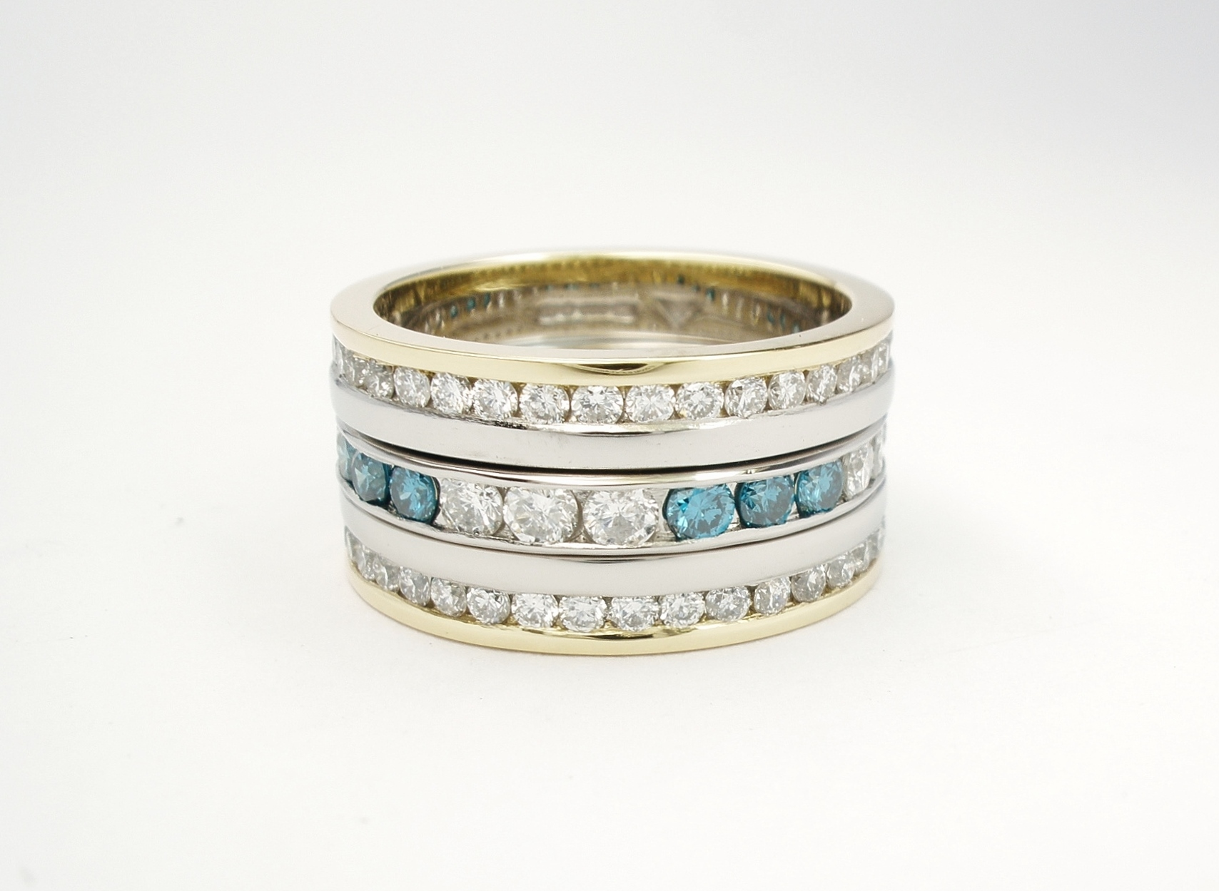 Triple stacking half eternity style white and blue diamond rings mounted in platinum & 18ct. yellow gold.