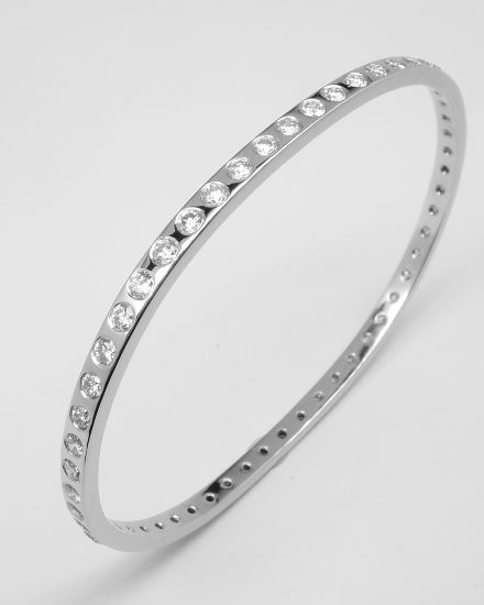 Palladium bangle flush set with 54 round brilliant cut diamonds.