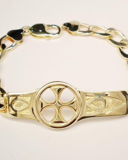 A 9ct. yellow gold bracelet with a hand carved 'Iona' style centre panel.