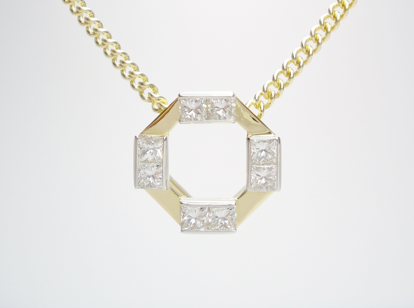 18ct. yellow gold & platinum octagonal pendant set with 8 princess cut diamonds.