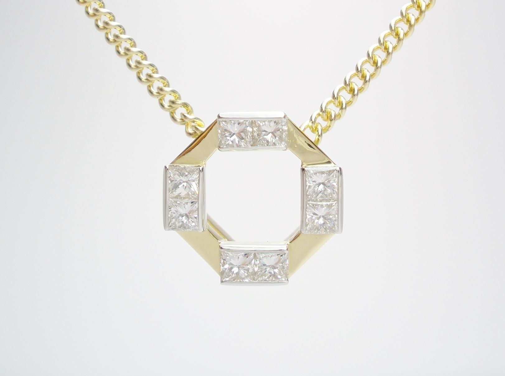 18ct. yellow gold & platinum octagonal pendant set with 8 princess cut diamonds.