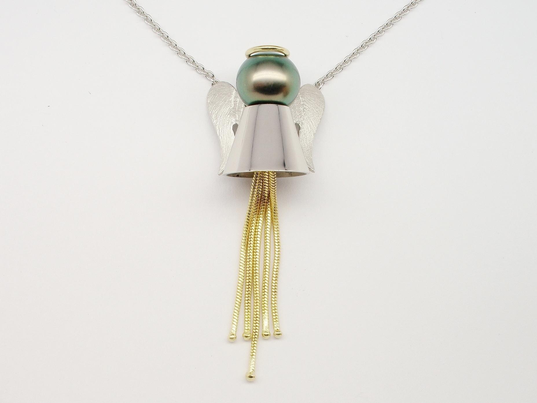Black Tahitian pearl 'Angel' pendant mounted in palladium and 18ct. yellow gold.