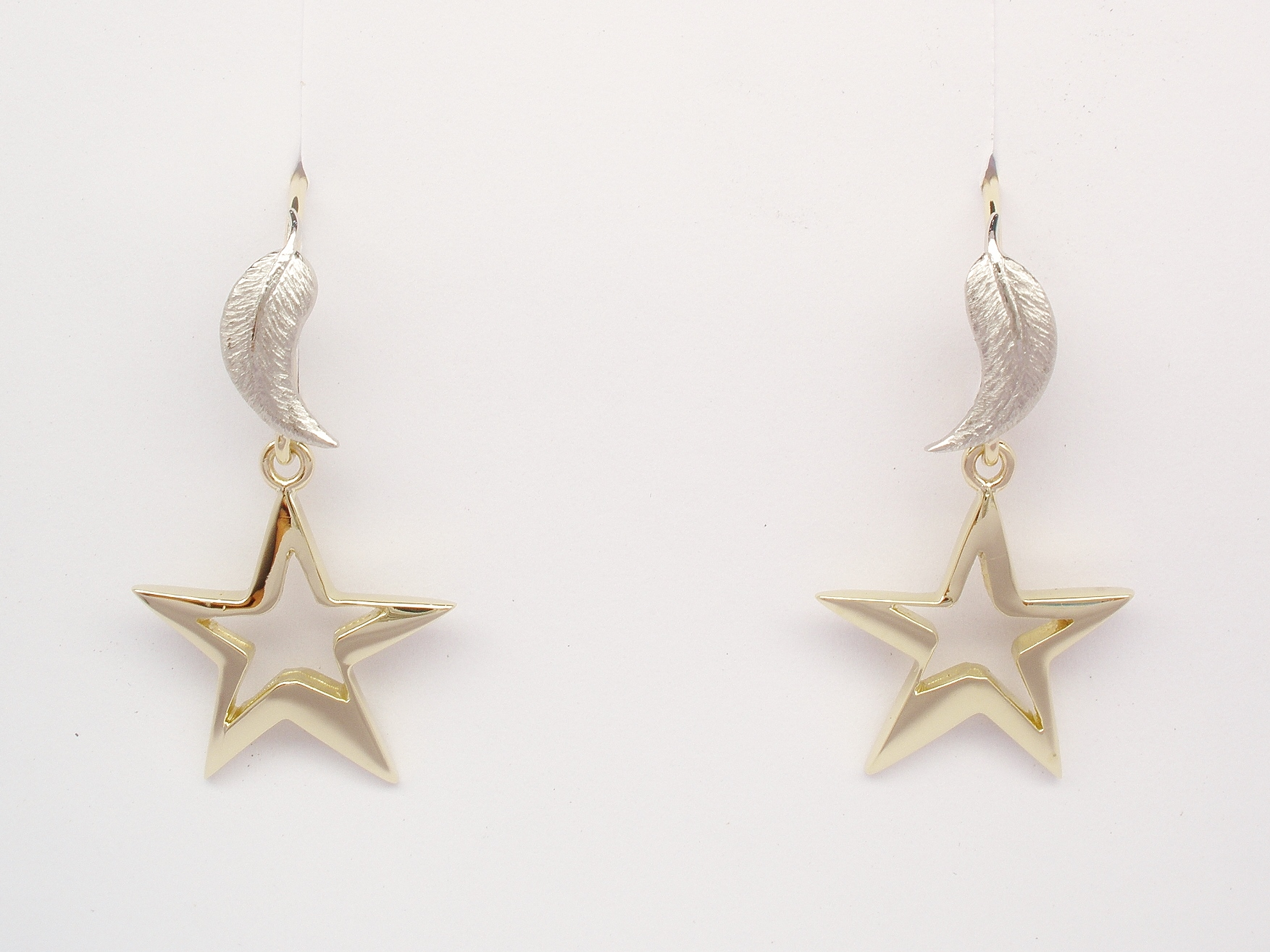 18ct. yellow gold and palladium feather and star earrings.