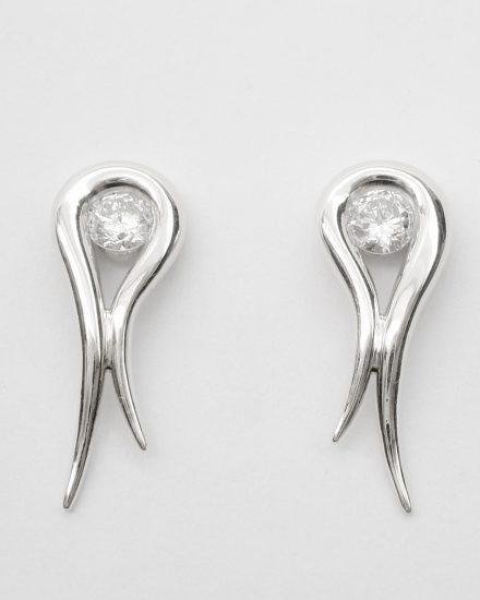 Palladium tapered loop earrings with a single round brilliant cut diamond set in loop.