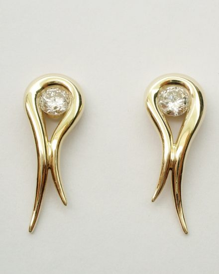 A pair of single stone diamond & 18ct. yellow gold tapered loop earrings.