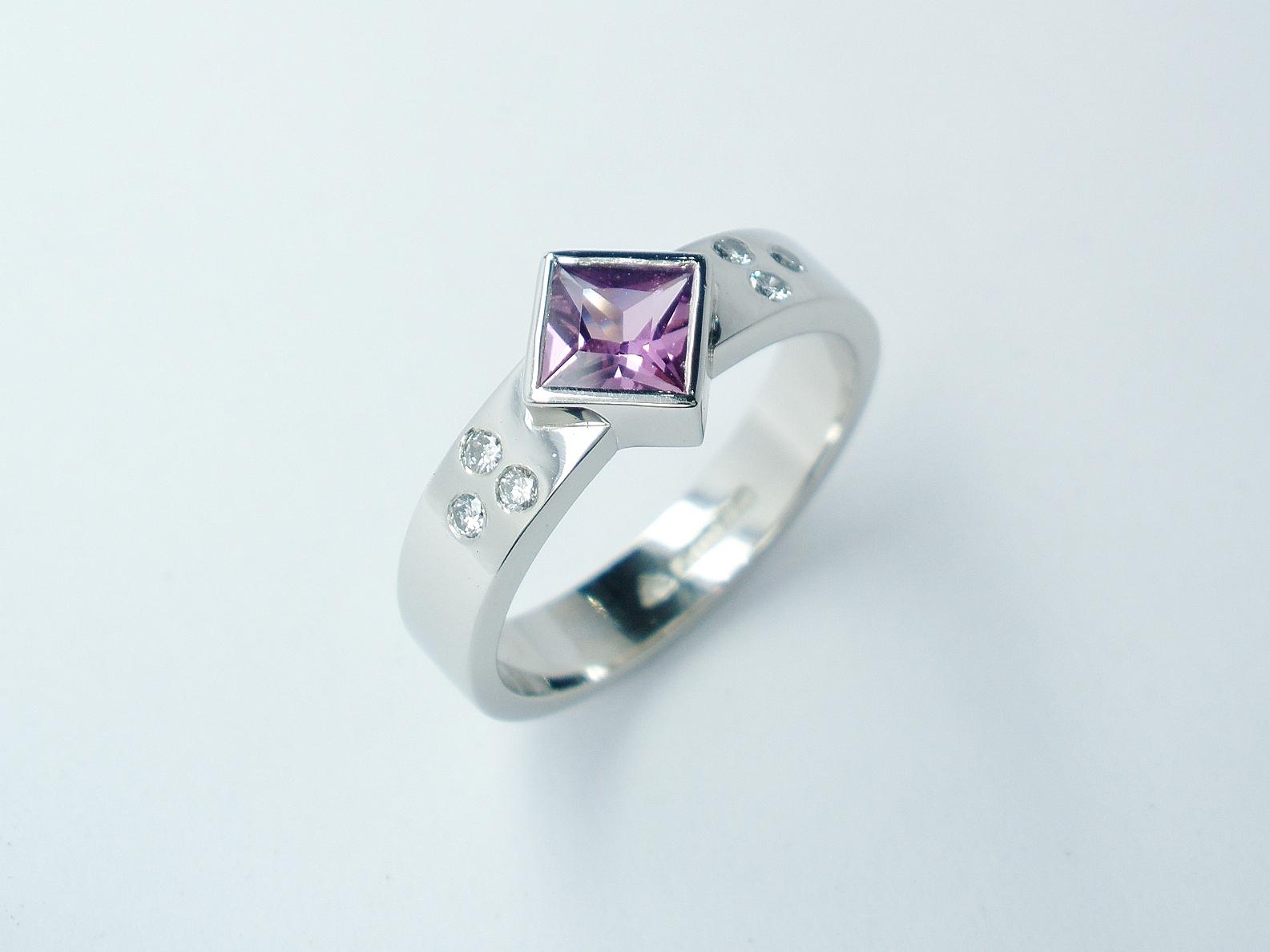 Square princess cut rub-over set purple sapphire and flush set diamond ring mounted in palladium.