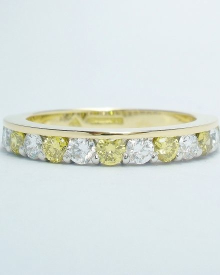Canary yellow diamond & white diamond eternity ring part channel set to 55% cover, mounted in 18ct. yellow gold and platinum