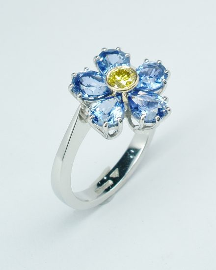 6 pear shaped sapphire and HTHP treated canary yellow diamond ring mounted in platinum & 18ct. yellow gold to mimic a Forget Me Not.