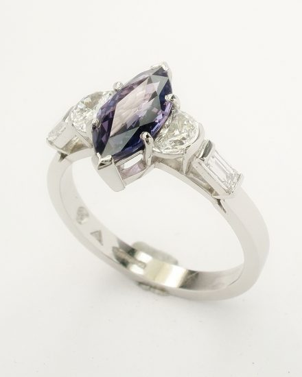 Purple Marquise cut sapphire, half moon cut diamond & baguette diamond 5 stone ring mounted in platinum.