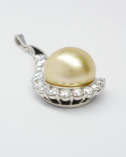 Natural golden pearl & part channel set diamond pendant mounted in palladium and platinum.