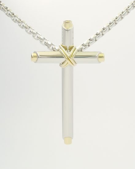 Platinum and 18ct. yellow gold tubular cross with fine 18ct. yellow gold binding wire.