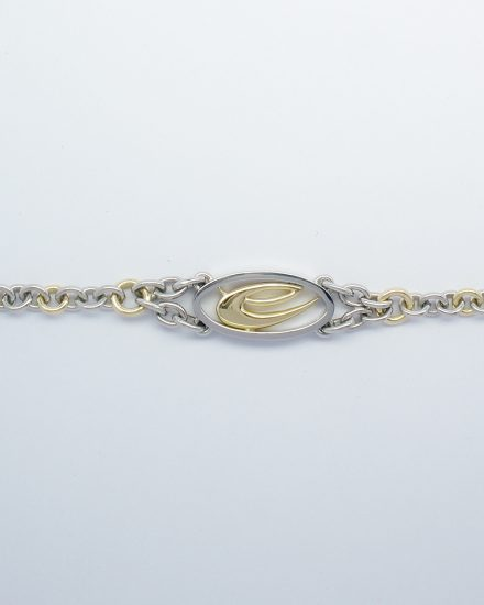 A palladium & 18ct. yellow gold bracelet with central oval panel and 18ct. yellow gold stylised initial.