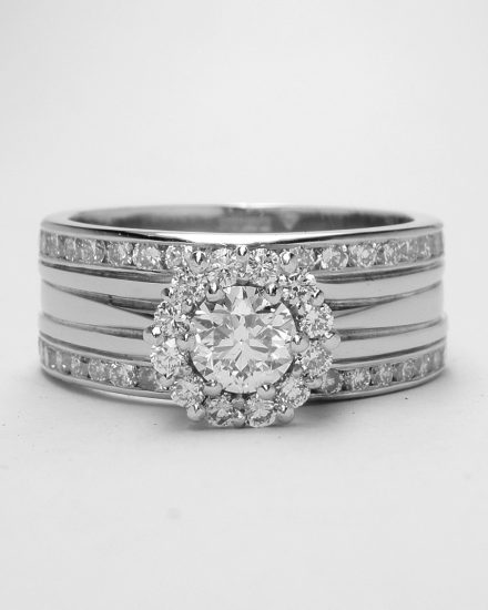 Diamond 'Halo' cluster and double channel set one piece engagement, wedding & eternity ring mounted in palladium and platinum.