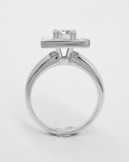 A 13 stone princess cut and round brilliant cut square halo cluster set in platinum.