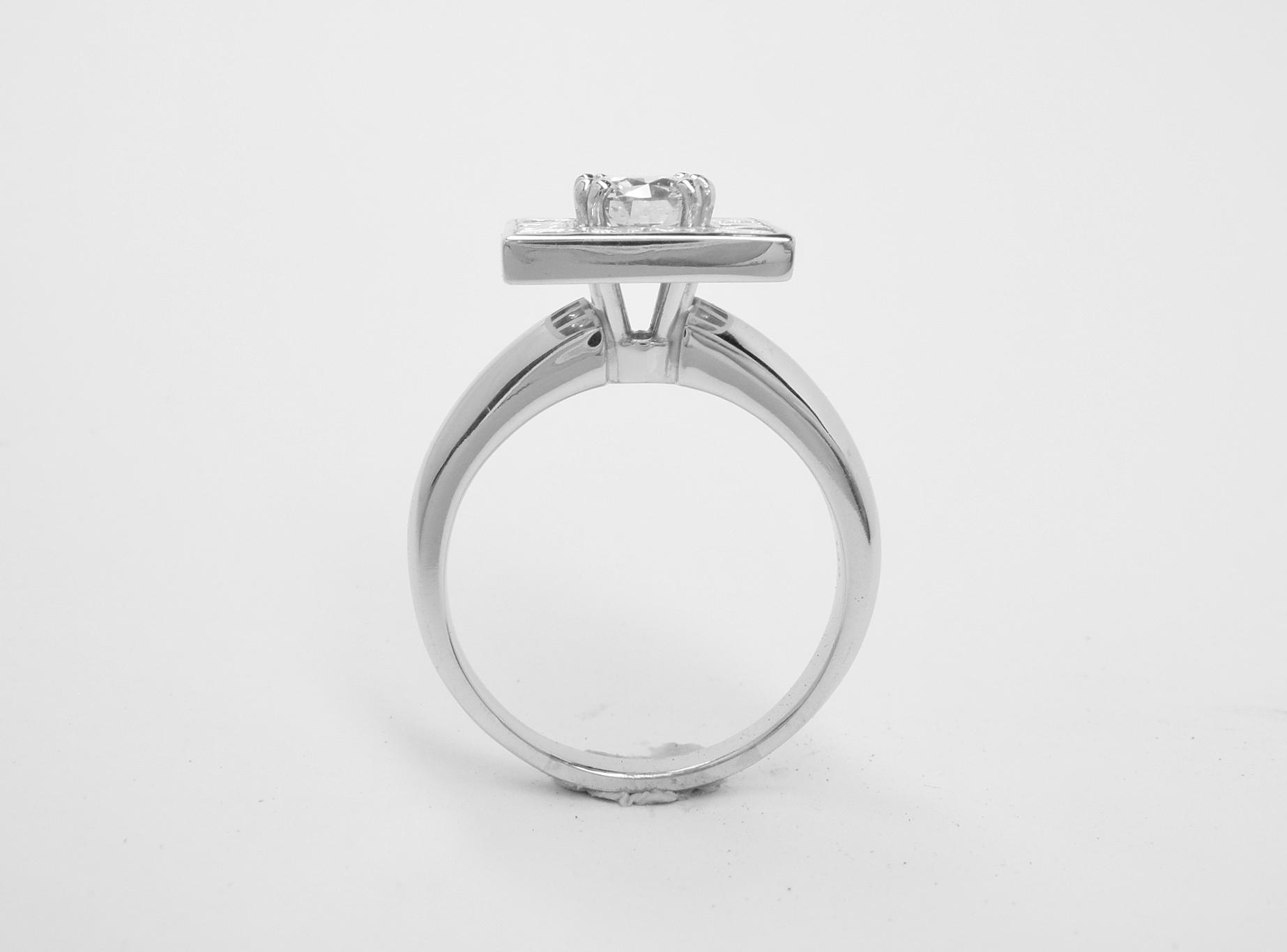 A 13 stone princess cut and round brilliant cut square halo cluster set in platinum.