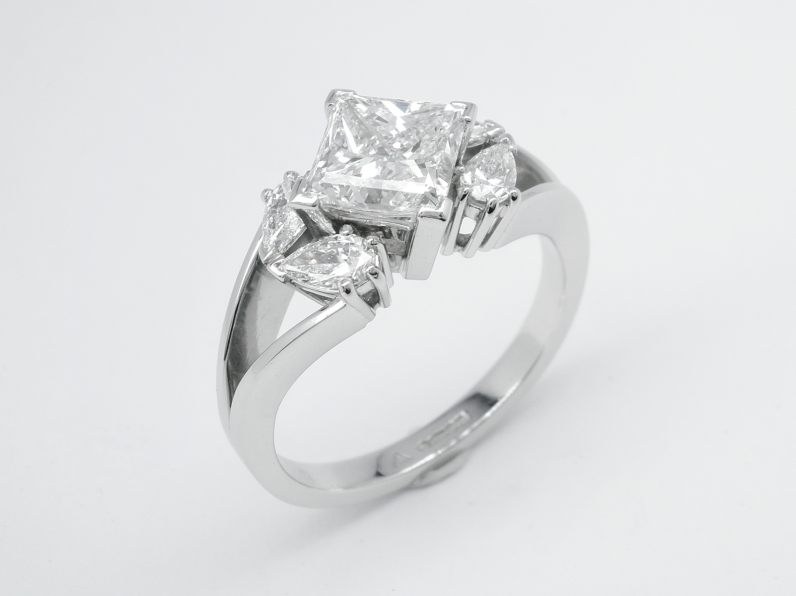 1.80ct. princess cut diamond & pear shaped diamond 5 stone platinum engagement ring.