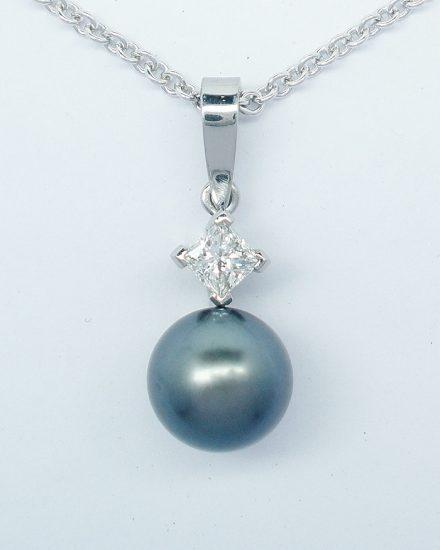 8mm diameter black Tahitian pearl and princess cut diamond pendant mounted in 18ct. white gold.