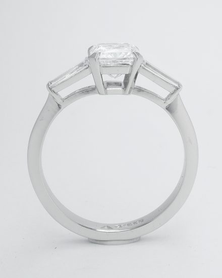 1.20ct. 'D' colour, VS2 clarity radiant cut diamond & tapered baguette diamond ring mounted in platinum.