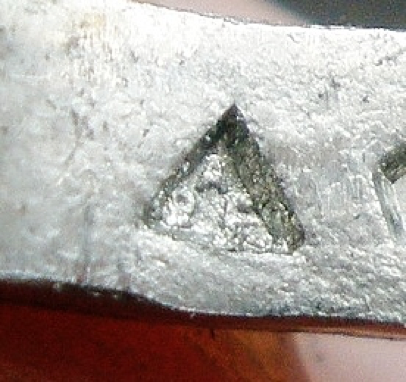 My APF mark on the inside of a ring with bruising on the outside edge