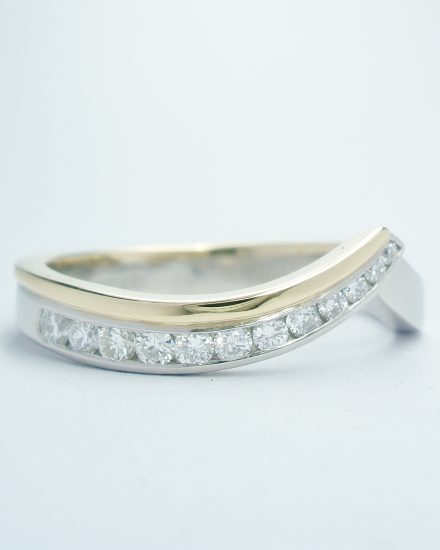 Palladium & 18ct yellow gold wedding ring shaped to fit around 2 stone open cross-over ring set with 12 round brilliant cut diamonds that taper in size.