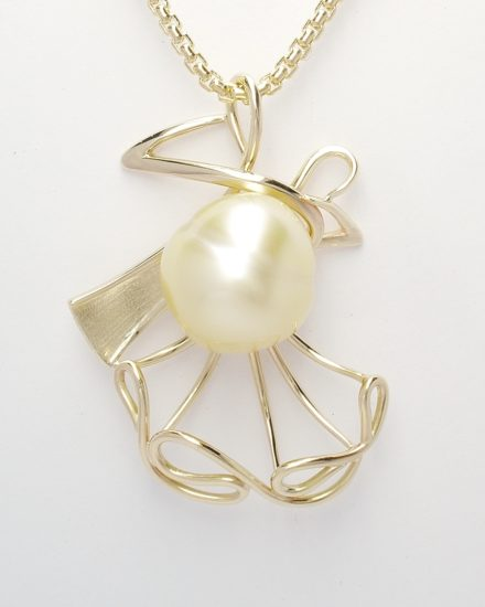 A golden pearl 'Ballroom Dance' style figurine pendant mounted in 9ct yellow gold.