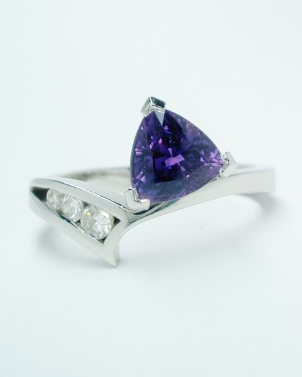 A trilliant purple sapphire and diamond 4 stone ring mounted in palladium and platinum and shaped to fit with the pink sapphire and diamond 4 stone ring.