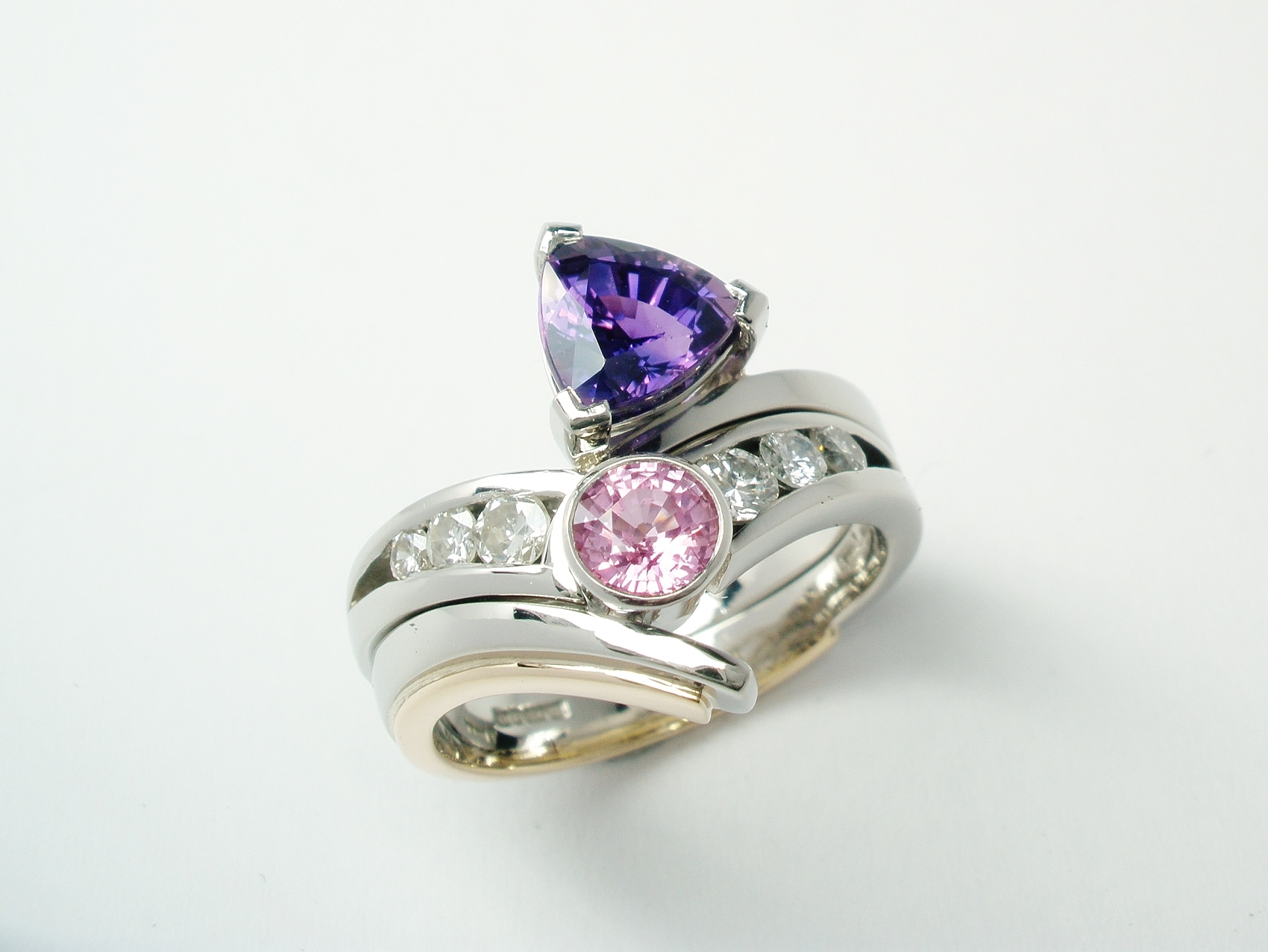 Purple trilliant sapphire and diamond ring fitting with round pink sapphire and diamond 4 stone ring.