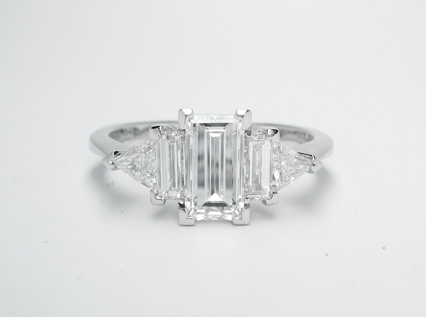 Baguette and triangle cut 5 stone diamond ring mounted in platinum.
