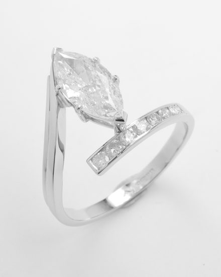 A 1.71ct. 'F' colour, SI clarity, marquise straight wishbone cross-over style ring mounted in platinum with 7 round brilliant cut diamonds channel set in the straight shoulder.