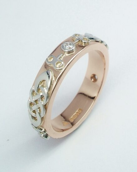 A diamond set red gold lady's wedding ring with platinum Celtic & Kazakh style motif overlays.