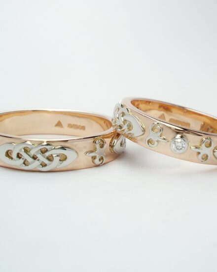 His & Her red gold wedding rings.