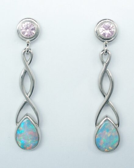 A pair of 18ct. white gold Celtic style drop earrings set with pear shaped opals and round pink sapphires.