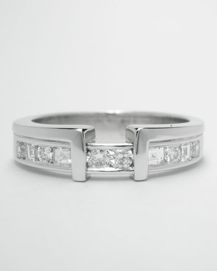 A platinum 10 stone square cut & round brilliant cut diamond wedding ring shaped to fit around a single stone princess cut engagement ring.