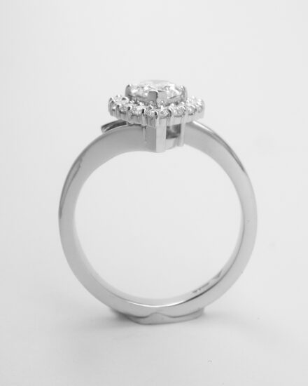A 16 stone pear shaped 'halo' cluster straight wishbone cross-over style ring, mounted in platinum.