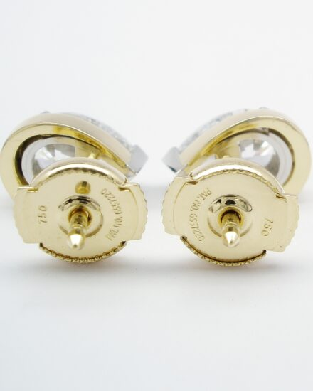 A pair of 1.00ct. pear shaped diamond ear studs mounted in platinum and 18ct. yellow gold with 'Guardian' safety spring fittings