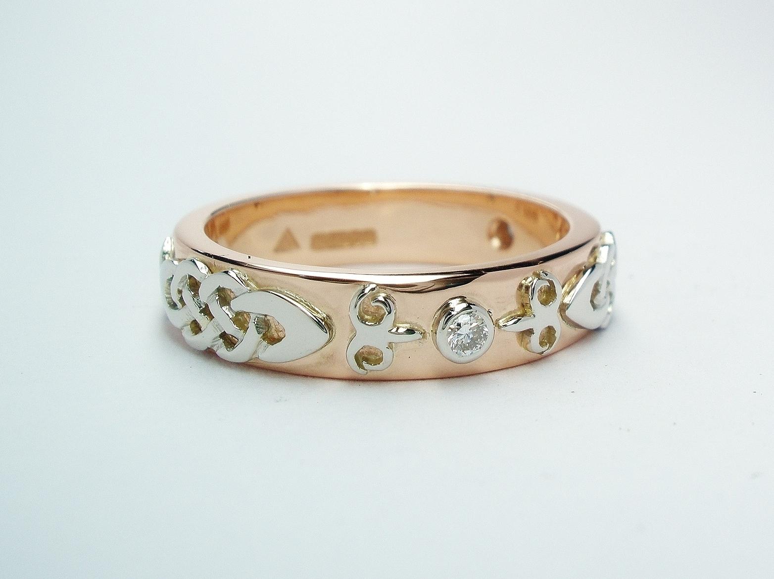 A diamond set red gold lady's wedding ring with platinum Celtic & Kazakh style motif overlays.