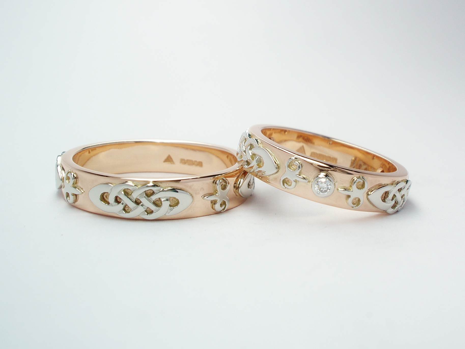 The matching pair or His & Her red gold wedding rings with platinum Celtic & Kazakh style motif overlays.