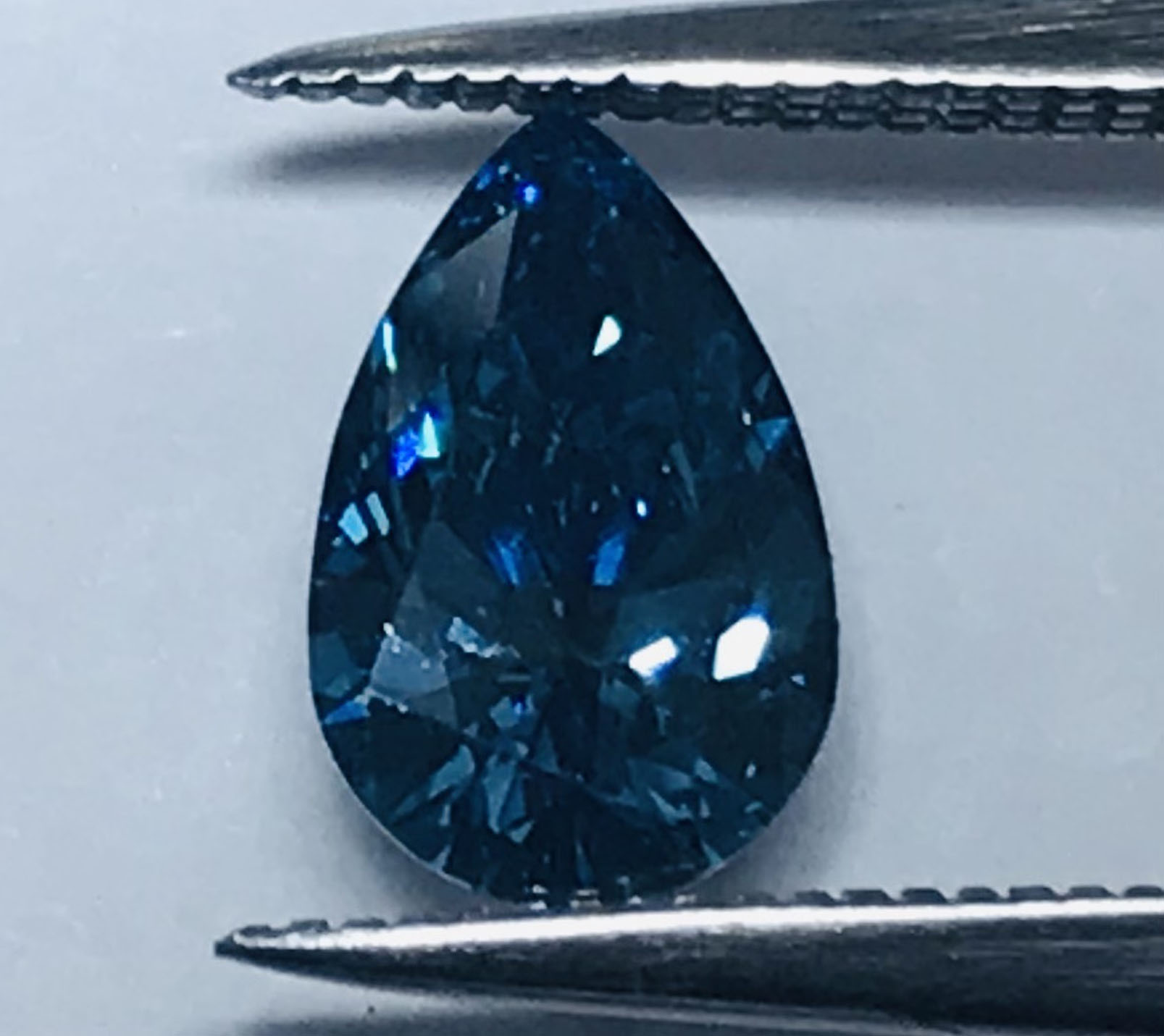 1.11 carat ocean blue pear shaped diamond